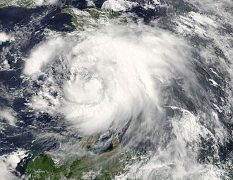 Effects of Hurricane Dennis in Jamaica - Tropical Storm Dennis organizing over the Caribbean Sea, south of Hispaniola, on July 6
