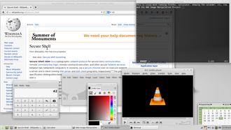 Free software - Example of a modern free software operating system running some representative applications. Shown are the Xfce desktop environment, the Firefox web browser, the Vim text editor, the GIMP image editor, and the VLC media player.