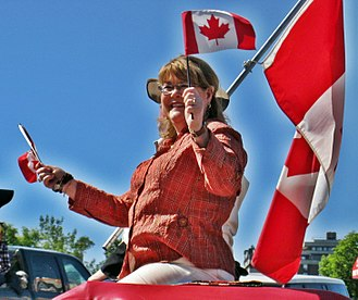 Diane Ablonczy - Diane Ablonczy waves the Canadian flag during the 2010 Calgary Stamepede parade.