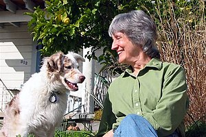 Donna Haraway - Donna Haraway and her dog (2006); photograph by Rusten Hogness