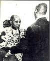Dr Banda being decorated with a leopard skin by the wife of the.jpg