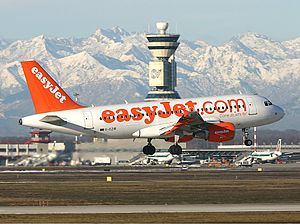 Milan–Malpensa Airport - EasyJet Airbus A319 landing at Malpensa with the Alps visible in the background