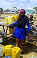 Ebyan Iftin rests after filling her jerry cans with water at a borehole in Dhobley (11400292076).jpg