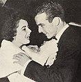 Elizabeth Taylor fixes Montgomery Clift's tie, 1949.jpg