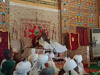 The Emir of Kano, Muhammadu Sanusi II, on his throne in 2016 Emir of Kano on his throne 092016.jpg