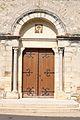 Espeluche - Portail église.JPG
