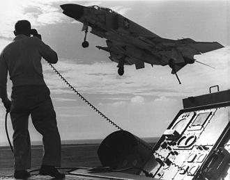 Landing Signal Officer - F-4B Phantom of VF-21 returns to USS Midway (CVA-41) off Vietnam in 1965. LSO Lt. Vern Jumper.