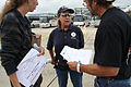 FEMA - 38112 - FEMA workers hand out fliers to evacuees returning to Louisiana.jpg