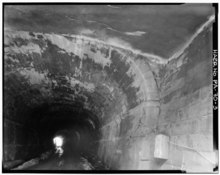 FORMER SOUTH PORTAL OF THE 79.4' TUNNEL EXTENSION - Pittsburgh and Steubenville Extension Railroad Tunnel, Between Fifth and Sixth Streets, East of Grant Street, Pittsburgh, HAER PA,2-PITBU,60-3.tif