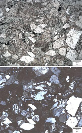 Greywacke - Photomicrograph of a feldspathic wacke (sandstone). Top image is in plane polarized light (PPL); bottom image is in cross polarized light (XPL). Blue epoxy fills pore spaces.