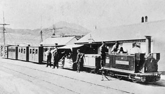 "Ffestiniog Railway - George England locomotive ""The Princess"" with passenger train at Porthmadog harbour station circa 1870."
