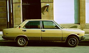 Fiat 131 with plastic dodgem panels in profile.jpg