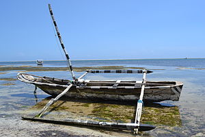 Fishing boat as viewed from Nyali Beach next to the Mombasa Beach Hotel during low tide and still conditions in Mombasa, Kenya.jpg