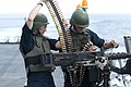 Flickr - Official U.S. Navy Imagery - A Sailor instructs an officer how to operate the 50. caliber machine gun. (1).jpg