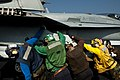 Flickr - Official U.S. Navy Imagery - Sailors push an F-A-18C Hornet in position..jpg