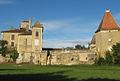 Fr-Chateau de Latoure-wide shot of courtyard buildings.jpg
