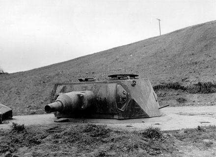 Tank turret mounted on a Tobruk at Widerstandsnest 68, June 1944 German turret at Omaha Beach.jpg