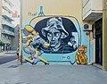 Graffiti de hombre en television.jpg