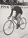 A male cyclist riding his bicycle on a track