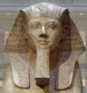 Large granite sphinx bearing the likeness of the pharaoh Hatshepsut, depicted with the traditional false beard, a symbol of her pharaonic power, residing in the Metropolitan Museum of Art