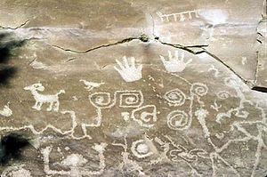 "Hopi mythology - A Hopi petroglyph in Mesa Verde National Park. The boxy spiral shape near the center of the photo likely represents the ""sipapu"", the place where the Hopi emerged from the earth in their creation story."