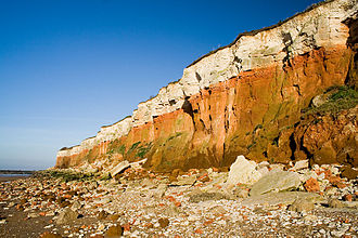 Hunstanton - The stratified Carstone (orange), red chalk limestone and white chalk cliffs on the beach at Old Hunstanton.