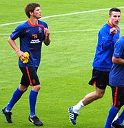Huntelaar (left) with Robin van Persie.
