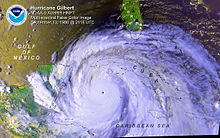 Satellite image of a tropical cyclone in the Western Caribbean Sea. It covers a large area and has a pinhole eye.
