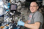 ISS-56 Ricky Arnold works in the Harmony module (2).jpg