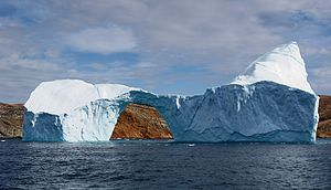 Arctic cooperation and politics - Iceberg between Langø and Sanderson Hope, south of Upernavik, Greenland.