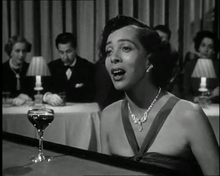 "Brooks as the singer of ""I Hadn't Anyone Till You"" in the film In a Lonely Place (1950)"