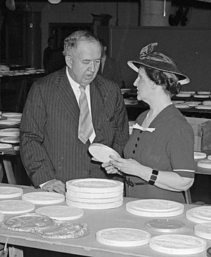 Jefferson nickel - Nellie Tayloe Ross (right), Director of the Mint, and Edward Bruce, Director of the Section of Painting and Sculpture, inspect candidates for the design of the new Jefferson nickel, April 1938