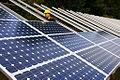 Installing solar panels (3049874118).jpg
