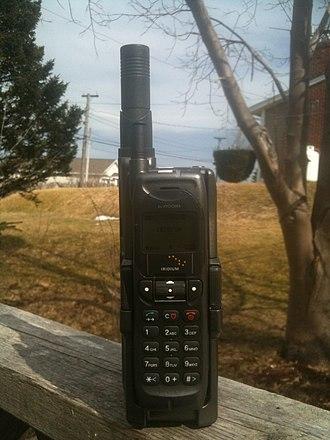 Iridium Communications - Image: Iridium Phone Kyocera ki g 100 GSM and SD 66 Iridium adapter This is one of the first iridium satellite phones manufactured for use on the iridium global satellite communications network 2014 04 19 14 48