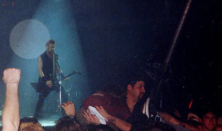 James Hetfield performing with the band during its Load tour in 1996 James Hetfield - Cardiff 1996.jpg