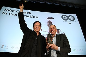 Belfast Film Festival - Festival Patron Máirtín Ó Muilleoir presents John Cusack with the festival's Réalta Award