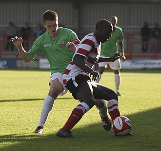 Kingstonian F.C. - A Kingstonian player in home kit in a 2012 match against Lewes F.C.
