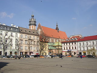 Plac Wolnica, a central market square in the Kazimierz district. The Polish Gothic Corpus Christi Basilica can seen in the background.