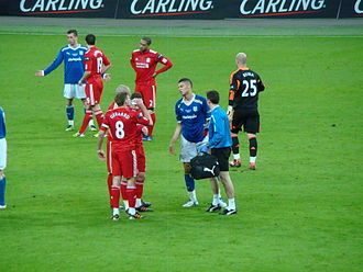 2012 Football League Cup Final - Players from both sides taking a break during the changeover of ends in extra time