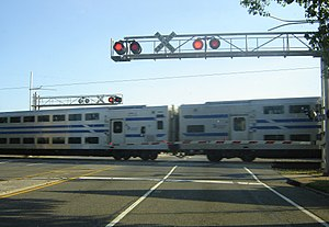 C3 (railcar) - C3 Bi-level coaches at grade crossing in Bethpage.