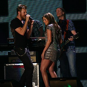 Hillary Scott - Scott (in silver dress) performing with Lady Antebellum in 2008