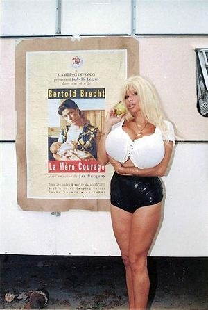 Lolo Ferrari - Lolo Ferrari in front of the poster of Mother Courage and Her Children in the summer of 1995 during the making of the movie Camping Cosmos.