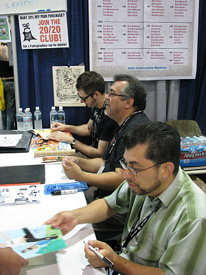 Love and Rockets (comics) - Gilbert and Jaime Hernandez at the 2007 ComicCon.  Gilbert is in the middle, Jaime is in the green shirt.