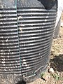 Low cost round water drums (with a door cut into them to enable easy access for emptying) (6881955475).jpg