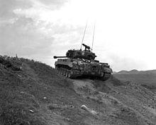 KOREAN WAR Marine Pershing tanks grind up heights along Naktong and give close support to Leathernecks driving enemy backward.