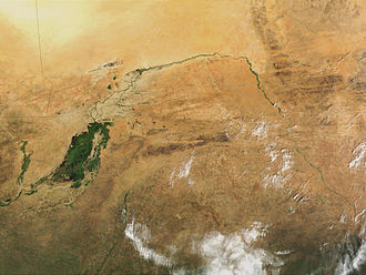Niger River - The great bend of the Niger River, seen from space, creates a green arc through the brown of the Sahel and Savanna.  The green mass on the left is the Inner Niger Delta, and on the far left are tributaries of the Senegal River.