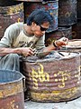 Man Welds Tub of Jaggary (from Sugar Cane) - West Mandalay - Myanmar (Burma) (11979632185).jpg