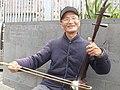 Man playing an Erhu in Melbourne.jpg