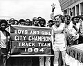 Mayor Raymond L. Flynn participating in Olympic torch relay with members of Boys and Girls City Champion Track Team (9516896205).jpg