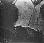 McCarty Glacier, terminus of tidewater glacier, with dark medial moraines, September 4, 1977 (GLACIERS 6626).jpg